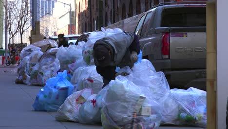 Piles-of-trash-line-a-New-York-City-street