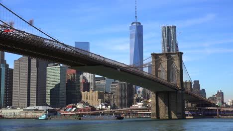 Establishing-shot-of-New-York-City-with-Brooklyn-Bridge-Freedom-Tower-and-East-River-1