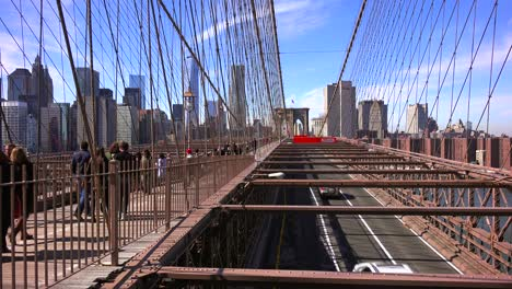 Pedestrians-cross-the-Brooklyn-Bridge-with-Manhattan-and-the-Freedom-Tower-in-the-distance-2