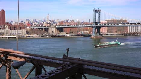 A-barge-passes-under-the-Manhattan-Bridge-in-New-York-City