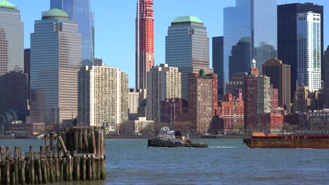 A-tugboat-pulls-a-barge-on-the-Hudson-River-in-New-York-City