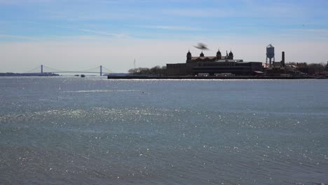 A-distant-view-of-Ellis-Island-in-new-York-harborimmigrants-from-Ellis-Island