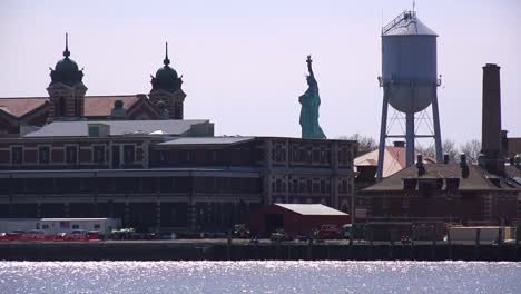 A-view-of-Ellis-Island-with-the-Statue-Of-Liberty-in-distance-