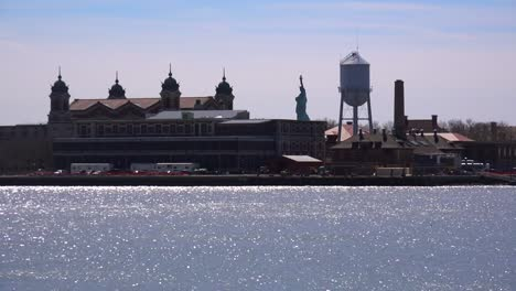 A-view-of-Ellis-Island-with-the-Statue-Of-Liberty-in-distance-1