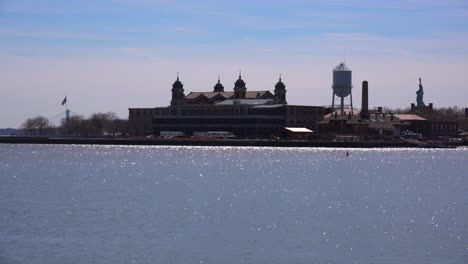 A-wide-view-of-Ellis-Island-with-the-Statue-Of-Liberty-in-distance-