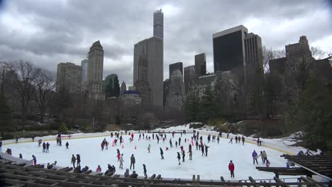 Amazing-tie-lapse-shot-of-Ice-skaters-in-Central-Park-New-York-City-moving-at-normal-speed-while-sky-moves-in-time-lapse