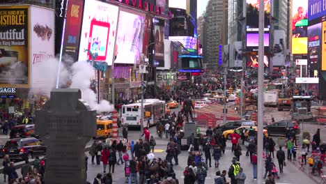 Crowds-of-cars-and-pedestrians-in-Times-Square-New-York-City-1