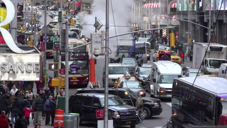 Crowds-of-cars-busses-and-pedestrians-in-Times-Square-New-York-City-2
