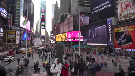Pan-across-crowds-of-people-and-bright-neon-advertisements-in-Times-Square-New-York-City