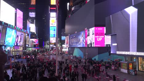 Pan-across-crowds-of-people-and-bright-neon-advertisements-in-Times-Square-New-York-City-1