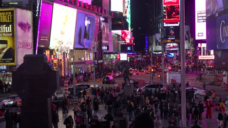 Nighttime-crowds-of-people-and-bright-neon-advertisements-in-Times-Square-New-York-City