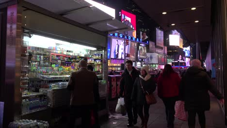 Nighttime-crowds-of-people-and-bright-neon-advertisements-in-Times-Square-New-York-City-1