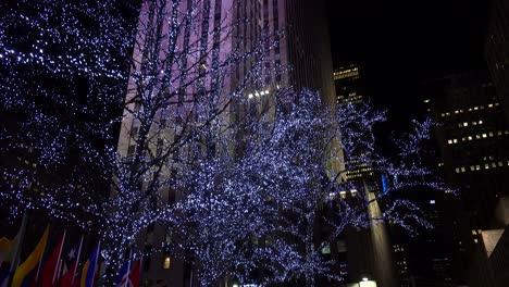 Tilt-up-shot-to-reveal-Rockefeller-Center-in-New-York-City-at-night