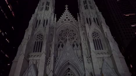 Tilt-up-to-New-York-s-magnificent-gothic-St-Patrick-s-cathedral-at-night
