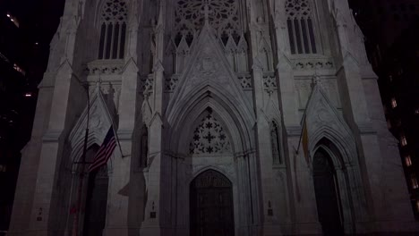 Tilt-down-to-New-York-s-magnificent-gothic-St-Patrick-s-cathedral-at-night