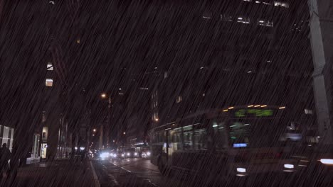 Traffic-moves-along-New-York-s-Fifth-Ave-at-night-during-a-major-rainstorm