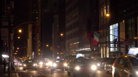Taxis-and-traffic-at-night-in-New-York-City
