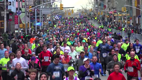 A-very-good-shot-of-the-New-York-City-Marathon-and-runners-moving-down-Manhattan-streets