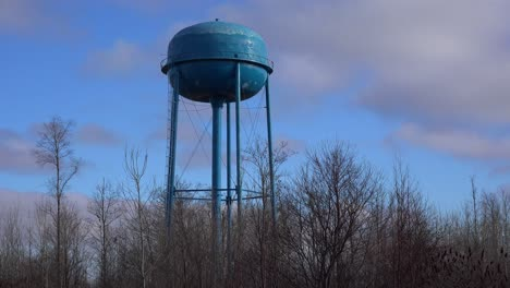 Time-lapse-of-clouds-moving-behind-a-generic-water-tower-in-a-Midwestern-town