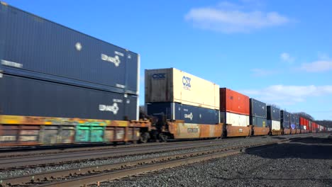 A-fast-moving-freight-train-passes-with-many-containers