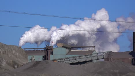 Global-warming-is-suggested-by-shots-of-a-steel-mill-belching-smoke-into-the-air