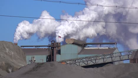 Global-warming-is-suggested-by-shots-of-a-steel-mill-belching-smoke-into-the-air-1