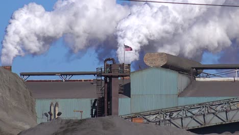 Global-warming-is-suggested-by-shots-of-a-steel-mill-belching-smoke-into-the-air-2