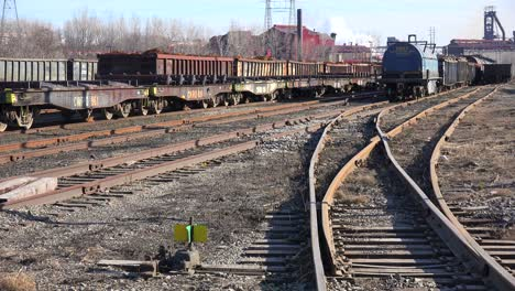 An-industrial-railyard-with-flatcars-and-tankers