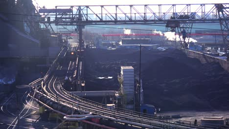 Establishing-shot-of-a-busy-steel-mill-with-ore-transported-through-an-aerial-skyway