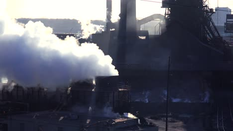 Establishing-shot-of-a-busy-steel-mill-with-ore-transported-through-an-aerial-skyway-1