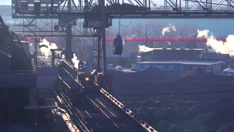 Establishing-shot-of-a-busy-steel-mill-with-smoke-belching-suggests-global-warming-1