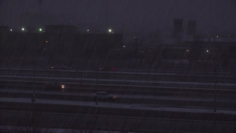 A-snowstorm-hits-near-an-interstate-highway-at-night