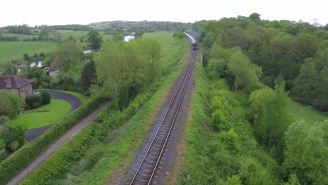 An-aerial-over-the-Orient-Express-steam-train-passing-through-the-English-countryside