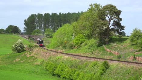 A-steam-train-passes-through-the-English-countryside-at-high-speed