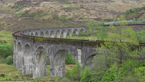 A-steam-train-passes-across-the-Glenfinnian-Viaduct-in-Scotland