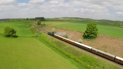 An-aerial-of-a-steam-train-as-it-passes-through-the-English-countryside-at-high-speed-2
