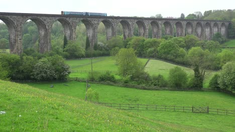 A-diesel-passenger-train-as-it-passes-over-a-viaduct-in-the-English-countryside