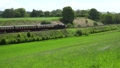 A-steam-train-passes-through-the-English-countryside-at-high-speed-1