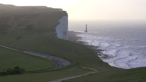 A-beautiful-establishing-shot-of-the-white-cliffs-of-Dover-at-beachy-head-England-with-lighthouse-
