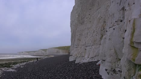 A-distant-woman-walks-along-the-White-Cliffs-of-Dover-near-Beachy-Head-in-Southern-England