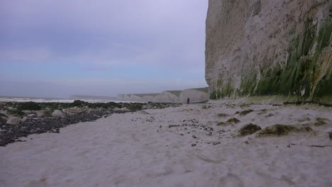 A-distant-woman-walks-along-the-White-Cliffs-of-Dover-near-Beachy-Head-in-Southern-England-2