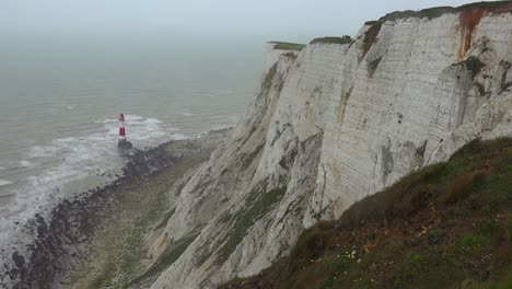 A-lighthouse-along-the-White-Cliffs-of-Dover-near-Beachy-Head-in-Southern-England-1