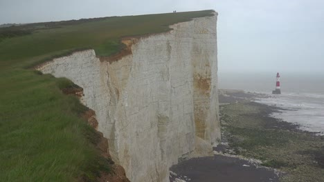 A-lighthouse-along-the-White-Cliffs-of-Dover-near-Beachy-Head-in-Southern-England-2