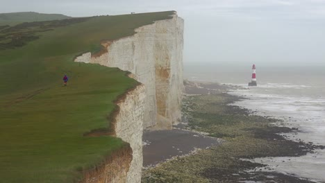 A-lighthouse-along-the-White-Cliffs-of-Dover-near-Beachy-Head-in-Southern-England-3