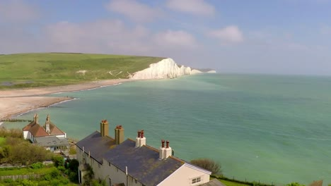 Areal-shot-of-beautiful-houses-along-the-shore-of-the-White-Cliffs-of-Dover-at-Beachy-Head-England