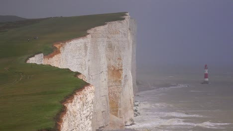 A-beautiful-establishing-shot-of-the-white-cliffs-of-Dover-at-beachy-head-England-with-lighthouse-1