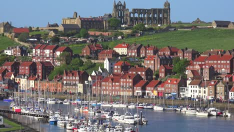 An-establishing-shot-of-the-town-of-Whitby-England-with-port-and-abbey-cathedral-distant