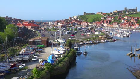An-establishing-shot-of-the-town-of-Whitby-England-with-port-and-abbey-cathedral-distant-1
