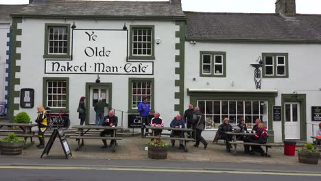 An-establishing-shot-of-Ye-Olde-Naked-Man-pub-and-bar-in-Settle-Yorkshire-England