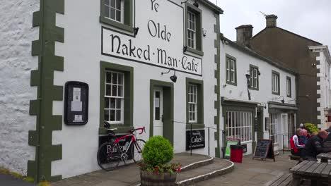 An-establishing-shot-of-Ye-Olde-Naked-Man-pub-and-bar-in-Settle-Yorkshire-England-1